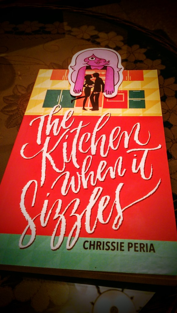 ReadinginBetween_The Kitchen When It Sizzles Cover